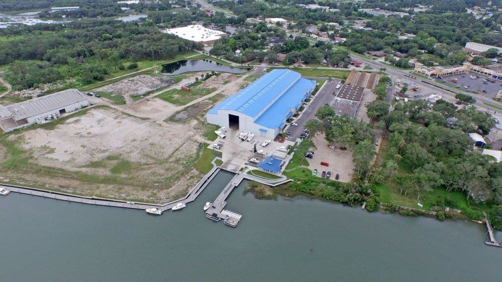 Aerial view over the water of the St. Augustine Shipyard