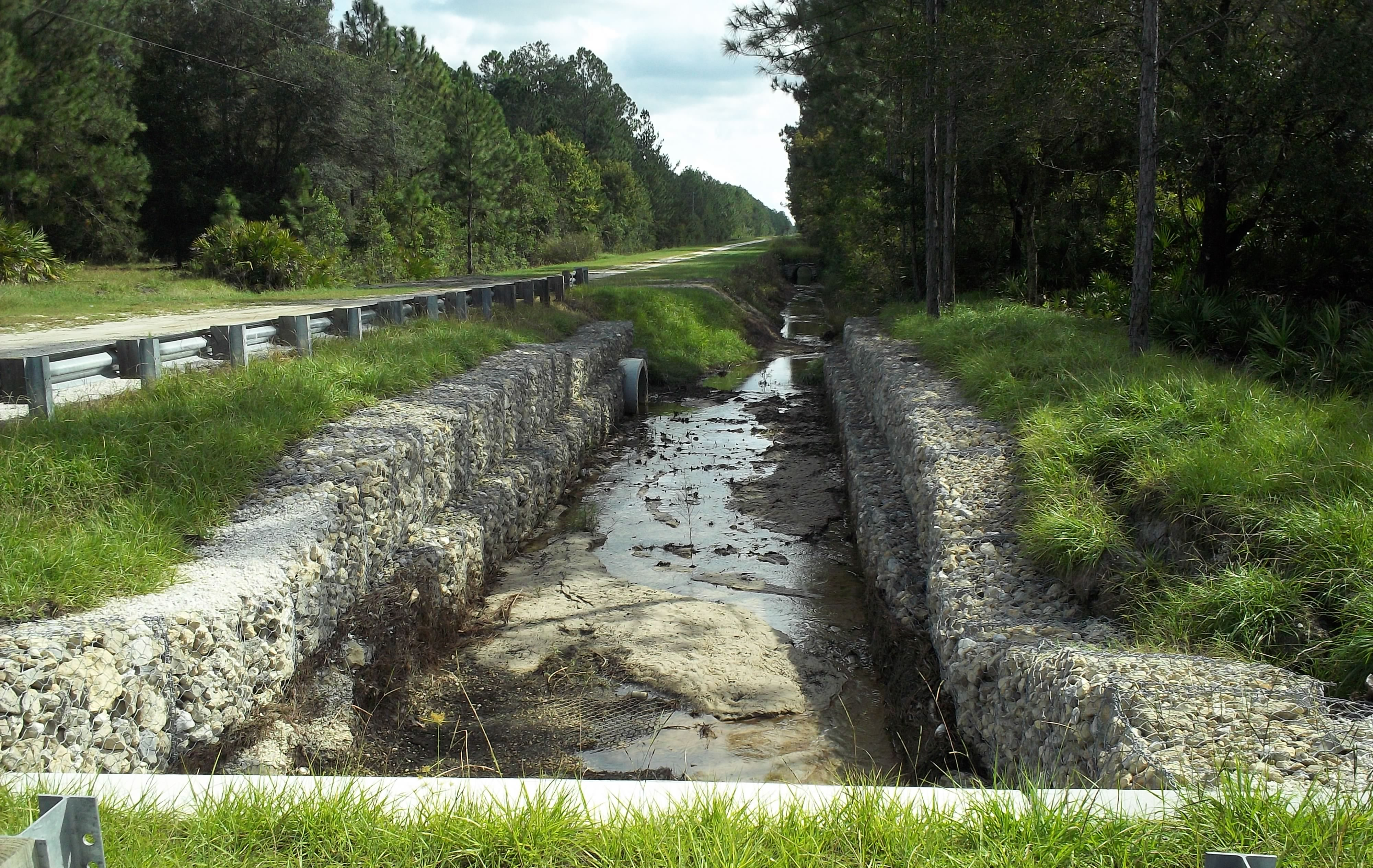 Photo of Palatka Kircherr Intersection Improvements showing the basket retaining wall along the road