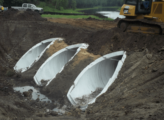 Three culverts at the Ashley Outfall project in Flagler Estates. The culverts are under the dirt with a tractor driving over it