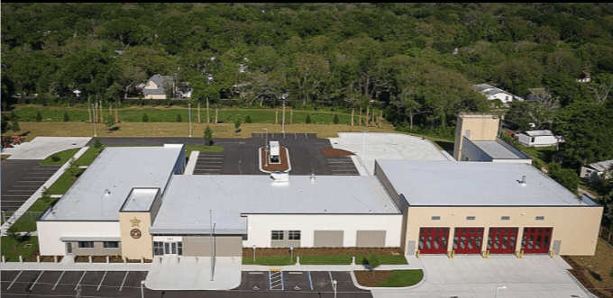 Aerial photo of the St. Johns County Fire Station & Sheriff's office showing the design of the building and parking lot. It shows the offices to the left and the garage for the fire station to the right