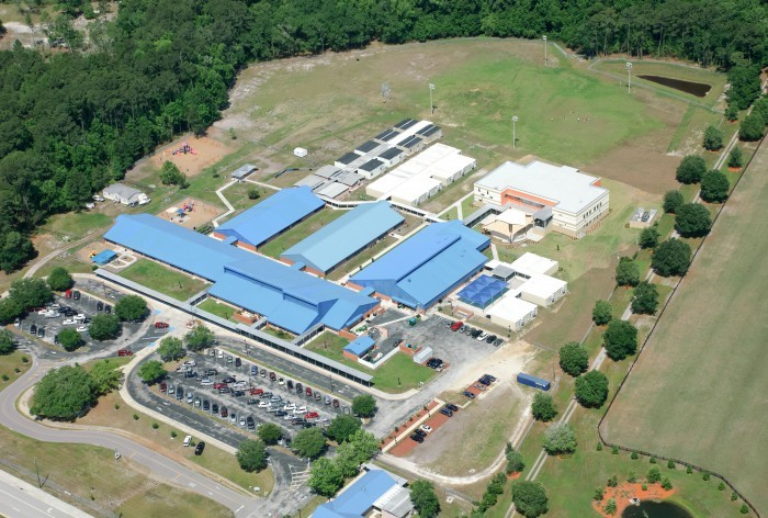 Aerial photo of Mill Creek Elementary showing the full design of the parking and school,