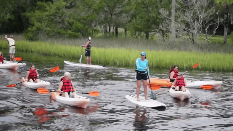 Photo of a group of people at the Nocatee Kayak Launch with kayaks and paddle boards