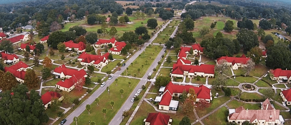 Aerial photo of Penney Farms showing the roadway design and structures with red roofs