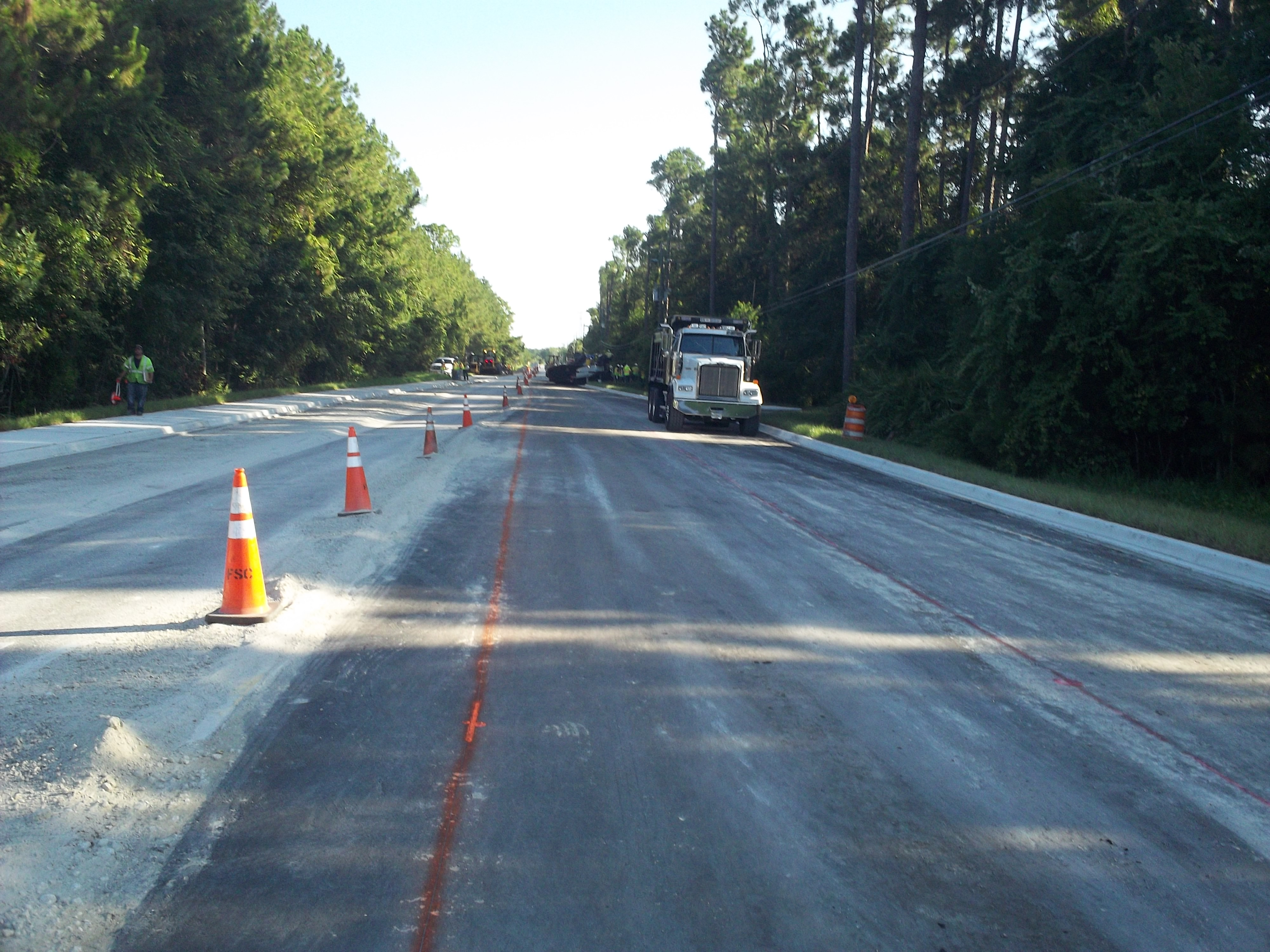 Roadway construction on Inman Road, showing the trucks, dirt , and cones of the road in progress